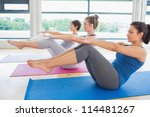 women in boat pose in yoga... | Shutterstock . vector #114481267