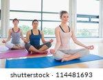 Women Meditating In Easy Yoga...