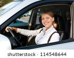 attractive woman driving the car and smiling - stock photo