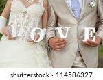 closeup shot of bride and groom ... | Shutterstock . vector #114586327