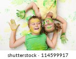 Painting is fun for kids - happy children play with the paint and look each other - stock photo