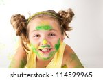 Portrait of a beautiful child enjoying his painting. - stock photo