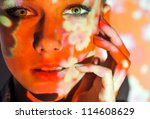 Portrait of beautiful sexy fashion  woman color face art - stock photo