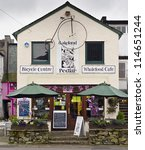 KESWICK, ENGLAND - JULY 26: The Lakeland Pedlar cafe on July 26, 2012 in Keswick, England. Keswick is a tourism hotspot of the Lake District, especially popular with walkers in the summer months. - stock photo