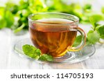 Stock photo cups of tea with mint on wooden table 114705193