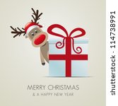 reindeer behind christmas gift box red ribbon - stock photo