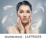 beautiful girl with a feathers - stock photo