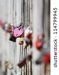 Railings with hanging locks - stock photo