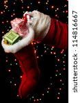 Santa Claus Hand Holding Gifts...