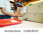 close up cash desk with mans... | Shutterstock . vector #114818167