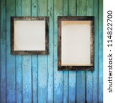 Blank photo frame hanging on old grunge wooden wall - stock photo