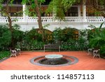 Small Fountain In A Garden Wit...