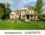 upscale suburban house | Shutterstock . vector #114870973