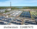 Industrial water treatment plant in evergreen forests - stock photo
