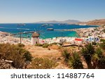 view of Mykonos, windmill and old port with cruise ships - stock photo