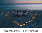 a young couple share a romantic ... | Shutterstock . vector #114892633