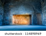 Warm and cold light in medieval castle - stock photo