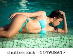 beautiful young woman lying by... | Shutterstock . vector #114908617