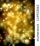 Christmas and holiday season background with with golden bokeh lights and sparkling stars - stock photo