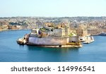 The mighty Fort St Angelo dominates Grand Harbour of Valetta, Malta - stock photo