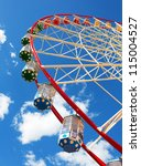 ferris wheel against blue sky | Shutterstock . vector #115004527