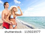 happy relaxing couple on the... | Shutterstock . vector #115023577