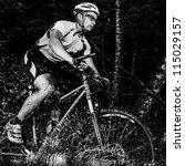 Mountainbiker With Splashing...