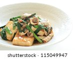 Chinese cuisine, leek and pork with Grilled Tofu stir fried - stock photo