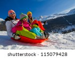 Winter fun, snow, family sledding at winter time - stock photo