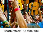 "WROCLAW - MAY 1: A crowd of people plays guitars in a Wroclaw market square at the ""Annual Thanks Jimi Guitar Festival"" in order to beat the Guinness Record on May 1, 2012 in Wroclaw, Poland. - stock photo"