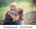 beautiful young mother and her... | Shutterstock . vector #115114453