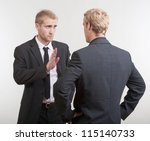 two you businessmen standing, discussing, arguing - stock photo