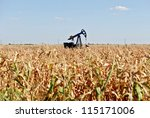Oil well in the middle of the corn field in Serbia - stock photo