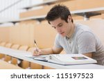 student sitting reading a book...   Shutterstock . vector #115197523