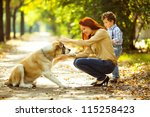 happy mother playing with her... | Shutterstock . vector #115258423