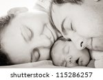 Sleeping Baby With Mom And Dad...