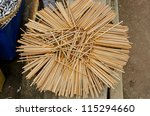 a pile of wooden chopsticks - stock photo