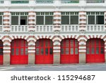 Facade of old fire station with red gates - stock photo