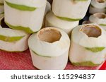 Stack of empty young coconuts - stock photo