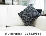 Cushion on modern leather sofa in cozy home - stock photo
