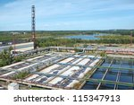 Groups of storage tanks with waste water - stock photo