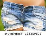 Sexy denim low-cut shorts closeup - stock photo