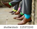 Funny colorful socks of groomsmen - stock photo