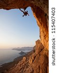 rock climber at sunset ... | Shutterstock . vector #115407403