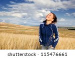 young woman enjoying nature - stock photo