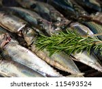 fish on grill with rosemary and olive oil - stock photo