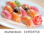 Sushi set with chopsticks on a white plate, horizontal shot - stock photo
