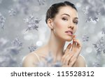 beautiful girl on the background of snow-flakes - stock photo