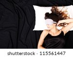 A young woman sleeping with a eye covering mask. - stock photo