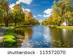 Path by the river in the park autumn season - stock photo